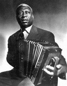 """Lead Belly playing an accordion. Lead Belly styled himself """"King of the guitar,"""" and despite his use of other instruments like the accordion, the most enduring image of Lead Belly as a performer is wielding his unusually large Stella twelve-string Louise Brooks, Instrumental, Lead Belly, Nirvana Songs, Mark Lanegan, Mandoline, Best Guitar Players, Le Piano, Delta Blues"""