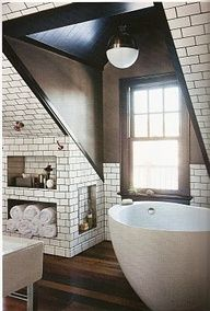 Attic bathroom with tile on the ceiling. Nice way to solve the slanted ceiling issue!