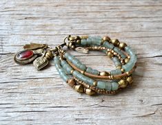 Bohemian bracelet, hand jewelry, beaded boho bracelet, hippie gypsy tribal jewelry, gift for her, LAST ONE Light up your look with this gorgeous five layer boho chic bracelet. Made with beautiful Indonesian glass beads in translucent muted green, brass beads from Africa, vegan suede in gold,