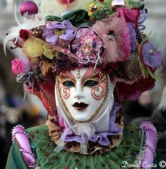 A Venetian Mask...beautifully colored costume and a mask with a sweet expression.