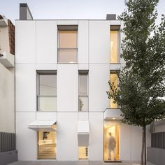 Hinged shutters camouflage with facade of Humberto Conde's Portugal townhouse