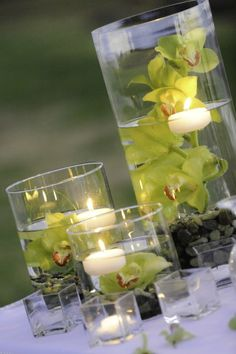 i am concerned the candle will burn the flower. haha. this is what im going for with sea glass instead of rocks though.