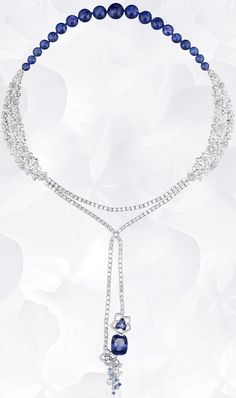 Necklace in platinum, diamonds, tanzanite, sapphires, set with a cushion-cut tanzanite