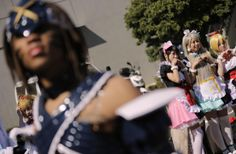 """Costume players, or cosplayers, pose for anime fans during AnimeJapan 2014 anime festival in Tokyo, Saturday, March 22, 2014. Cosplay, or """"costume play,"""" is a growing art form in which fans create detailed costumes to accurately represent their favorite characters in pop culture."""