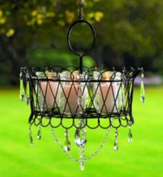 A darling outdoor Chandler made of mason jar-candles, wire basket, and crystals! Lovely