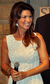 """Shania Twain, OC--(born Eilleen Regina Edwards; August 28, 1965) is a Canadian singer and songwriter. Twain has sold over 85 million records and is the best selling female artist in the history of country music, which garnered her honorific titles including the """"Queen of Country Pop""""."""