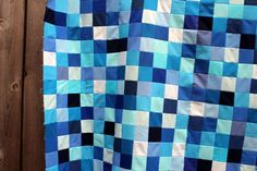 Christines quilt detail. Solid colors - 2 l/2 in strips sewn together in a tube and then cut apart.  I want to try one of these.