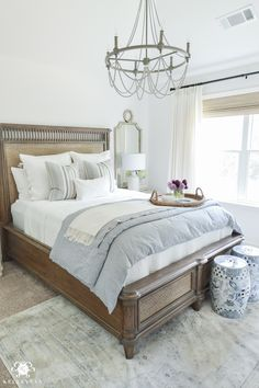 Shades of Summer Home Tour with Neutrals and Naturals-blue and white guest bedroom with cane bed and Sherwin Williams Alabaster Paint