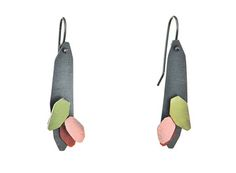 Garden earrings  YUKO FUJITA-JP/AU   Oxidised sterling silver, green and pink paint    Yuko's pieces are realised through a spontaneous reaction to her materials, which creates outcomes that are never the same, reclaiming found objects as wearable sculptures. She is interested in making contemporary jewellery that interacts with the wearer. Yuko gives free reign to the interplay between the fundamental qualities of material,...