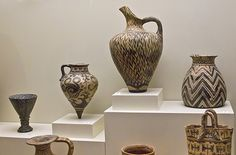 """Minoan pottery at the Iraklio museum. From around 2700 to 1450 BC, the Minoan civilization flourished as a seafaring and mercantile culture. This vibrant culture was centred around the island of Crete and eventually dominated the Agean region. The Egyptians called the Minoans """"the Sea Peoples"""" and had a fond appreciation for Minoan pottery and ceramics, prized for their innovative shapes and sea-inspired designs"""