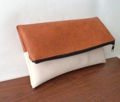 Hey, I found this really awesome Etsy listing at https://www.etsy.com/listing/117466599/tan-and-ivory-foldover-clutch-large