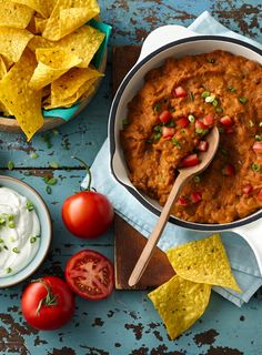 This quick and easy dip will be your family's new go-to. Packed with cheesy goodness, taco meat, beans and salsa...what's not to love?