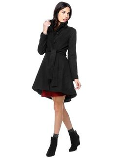 Dramatic flared coat with with elliptical high-low hem, button front closure and standing collar. Includes a tie-waist belt for a flattering...