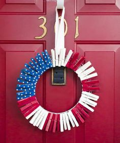 "Buy a pack of at least 70 clothespins and spray-paint them in red, white, and blue. Glue stars punched from cardstock on the blue pieces and arrange all of the painted clothespins on a 12"" wire wreath."
