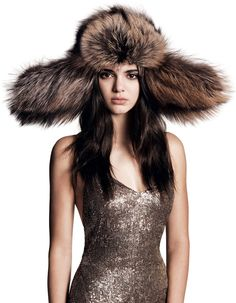 Head Game - An unexpected accessory like this fur-flap hat neutralizes the glamour of a sparkling evening gown—while also doing wonders for heat retention. Ralph Lauren Collection hat and dress.