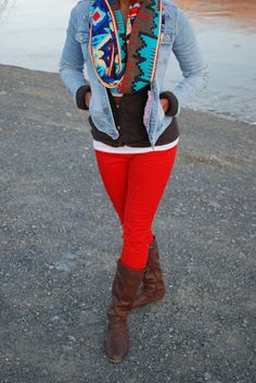 Black top, denim button up, red pants, brown boots, scarf