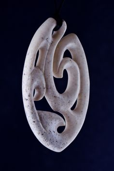 A contemporary fish hook from Walrus jaw bone... This is a great material and really nice to carve...