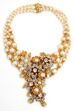 I absolutely love this dramatic vintage inspired necklace by Miriam Haskell for J.Crew.  I really want it for my own wedding!!