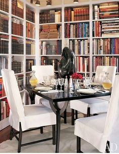 """""""I love the corner for books and dining, where I can read, write, and entertain,"""" says Juan Montoya of his New York apartment's cozy library/dining nook, the centerpiece of which is a 1959 bronze by Jean Gabriel Chauvin 