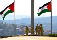 Palestinian flags flying by the Rawabi visitor center in the West Bank Photo By: TOVAH LAZAROFF
