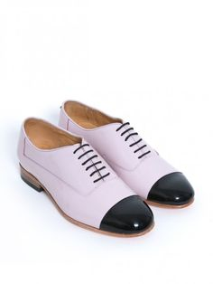 Baby pink with black cap toe. $225.25 Menswear meets ladylike coloring. These beg for flirty dresses.