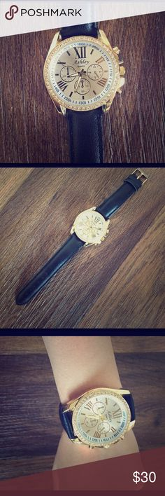 Watch Black, gold and silver watch. Could be worn with any jewelry or outfits since it has all the main colors in it. Ashley Accessories Watches