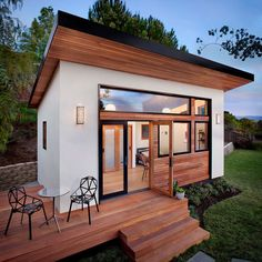 This contemporary 264 square foot prefab home, designed by Avava Systems, was packaged and brought to the client's property as just 64 flat-packed components.