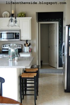 Painted Kitchen Cabinets - Before & After   Color: Sherwin Williams Pro Classic color match Navajo White