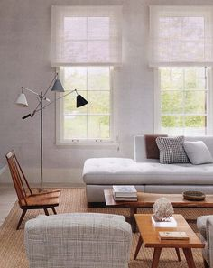 Modern and minimal. Soft colour balance with light shades, letting in the sunshine to this living room.