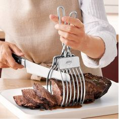 Roast cutting tongs. | 10 Cooking Tools That Will Make Your Holiday Feast More Manageable