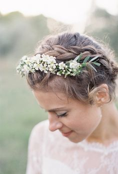Brides.com: . Braided Crown   We love the simplicity of a braided crown for a spring or summer wedding. The addition of a dainty floral headband is so romantic, and can be customized to match your bouquet.   See more wedding updos.