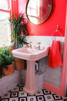 pink bathroom Amys pink and marble bathroom with black and white tiles, green houseplants and brass accents. Red Bathroom Decor, Green Bathroom Accessories, Peach Bathroom, Small Bathroom, Bathroom Black, Bathroom Ideas, Little Girl Bathrooms, Brick Bathroom, Colorful Bathroom