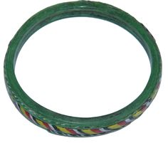 An Islamic green glass bangle of almost circular form decorated with two thin applied white and blank bands and a central thicker yellow, black, white and red band. Bangle measures 79 mm/3.11 ins. maximum external diameter and is 8-11 mm/0.3-0.4 in. thick. Some minor wear particularly to the thinner applied bands, but overall a nice example. Egypt, Islamic period, c. 9th-15th Century A.D.