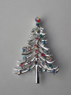 Dodds Signed 1960's Christmas Tree Pin, Aurora Borealis Crystal Rhinestones, Book Piece by VintageUndertheSea on Etsy