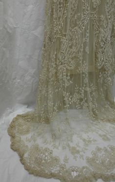 1930s wedding dress with a scalloped train. Collection: Royal Pump Room/Harrogate Museum.