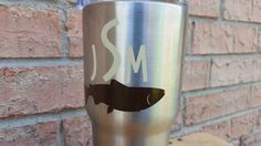 This is a vinyl monogram decal that can be placed on any kind of cup, tumbler, or water bottle / Nalgene. The letters and fish can be any colors you choose. If you order and leave a cell phone number, I will text you a proof, and a picture of the colors so you can give a final ok.  GLITTERY COLORS AT NO EXTRA COST!  Please leave initial details in the order form.