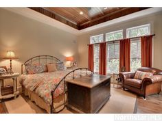 Beautiful master bedroom with hardwood paneled tray vaulted ceiling.