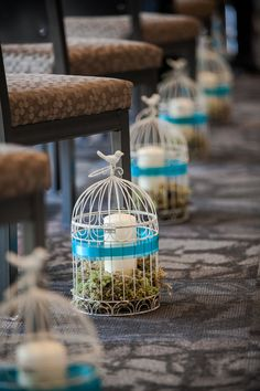 Bird Cages Lining the Aisle| Photo:  sugarandsoulphotography.com