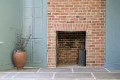 An exposed brick chimney breast and Farrow and Ball Oval Room Blue on the walls work perfectly with the earthy tones of our Umbrian Limestone. Living Room With Fireplace, Home Living Room, Living Room Decor, Cottage Fireplace, Dining Room, Brick Chimney Breast, Exposed Brick Fireplaces, Chimney Decor, Oval Room Blue