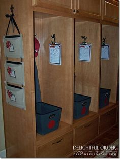Each member, especially kids get their own cubby. The papers hanging on the side include chores lists and schedules. There is drawer at the bottom that holds their shoes. So smart.