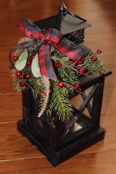 Replace fuchsia hanging planters for holiday season. Several lantern options available at Craft Warehouse. Place Light-sensing LED candle inside.