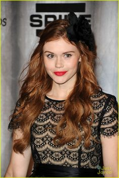 Holland Roden at the 2011 Scream Awards held at Universal Studios on Saturday (October 15, 2011) . Holland wore a Donna Morgan dress, Christian Louboutin heels, a Coach clutch, and a Ban.do headband.