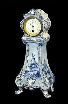 "Antique blue Delft clock, 15"" h x 16"" w x 4"" d. Property from various fine estates.  EST: $600 - $1,000      High Bid: 450.00 USD -"