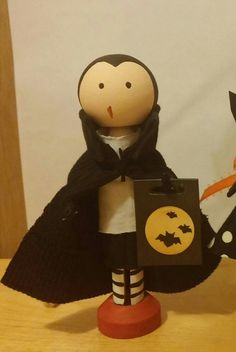 This little guy is all vamped up for trick or treating! Handmade and hand painted clothespin doll.