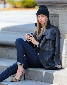Cara Delevingne Photos Photos - British model Cara Delevingne poses for a DKNY photoshoot in New York City, New York on March 20, 2013. - Cara Delevingne Poses for DKNY