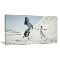 """DesignArt 'Huge Horse and Lady on Desert' Photographic Print on Wrapped Canvas Size: 16"""" H x 32"""" W x 1"""" D"""