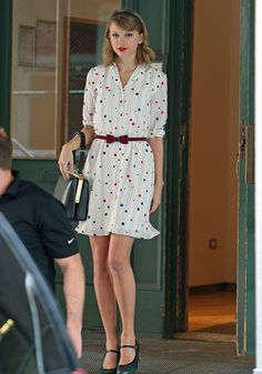 Taylor leaving a gym in New York City on May 2, 2014 wearing a Zooey Deschanel for Tommy Hilfiger dress, Marc Jacobs heels, and an Accessorize belt with a Dolce & Gabbana purse.