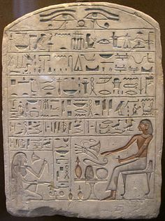 The offering formula shown on a funerary stela. On this particular stela, the formula begins on the first line and reads from right to left.  The Ancient Egyptian offering formula, was written in ancient Egypt as an offering for the deceased.