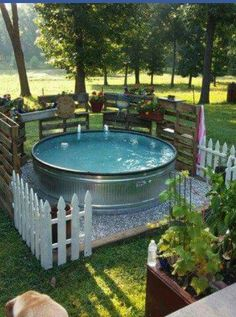 Swimming pool from 8 39 stock tank it has a small sand - How to filter a stock tank swimming pool ...