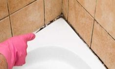 Tile caulk is a rubbery material that is used to line the area between tiles and the edges of a bath or sink. Due to its frequent contact with water, the caulk can become moldy and discolored. Remove Mold From Shower, Get Rid Of Mold, Bathtub Caulking, Clean Bathtub, Grout, Mold And Mildew, Image House, Spring Cleaning, Holidays And Events